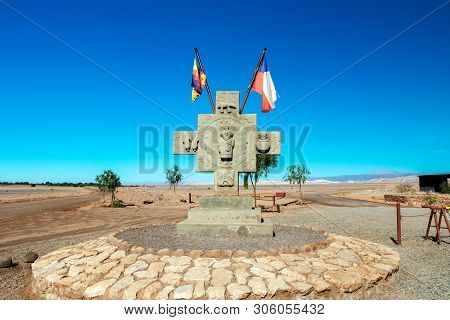 National Chilean Flag Flying With Blue Sky Background In Atacama Desert, Chile