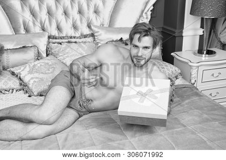 Happy Birthday To You. Sexy Man Smiling With Birthday Gift In Bed. Happy Man Holding Birthday Presen