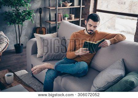 Portrait Of Handosme Focused Pensive Man Hold Hand Have Recreation She Heis Vacation Sit Divan Comfy