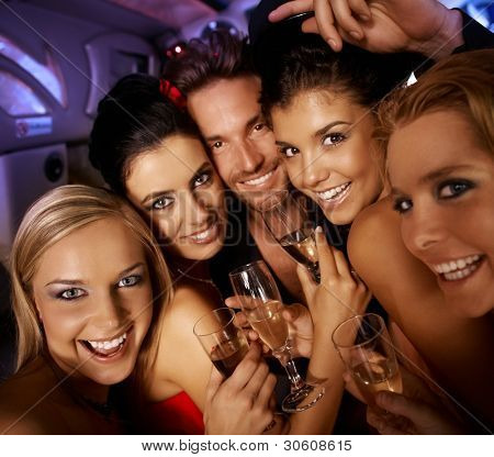 Young attractive people having party fun, drinking, laughing.?