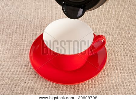 Empty Red Coffee Cup About To Be Filled