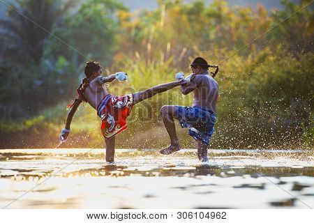 The Fighter Tying Tape Around His Hand Preparing To Fight,thai Boxing At The River,boxing Fighters T
