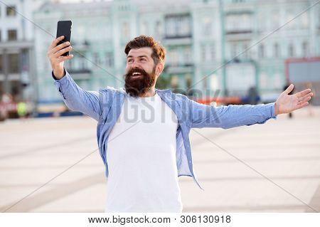 Hello World. Man Taking Selfie Photo Smartphone. Streaming Online Video Call. Mobile Internet. Touri