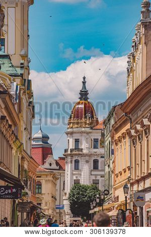 PECS, HUNGARY - JUNE 2019: View on people as they pass by on the pedestrian zone in the downtown of the city June 2019 in Pecs, Hungary