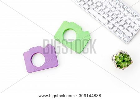 Photo Camera For Blogger With Keyboard On White Background Top View