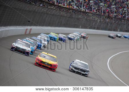 June 10, 2019 - Brooklyn, Michigan, USA: Joey Logano (22) races down the front stretch during the FireKeepers Casino 400 at Michigan International Speedway in Brooklyn, Michigan.