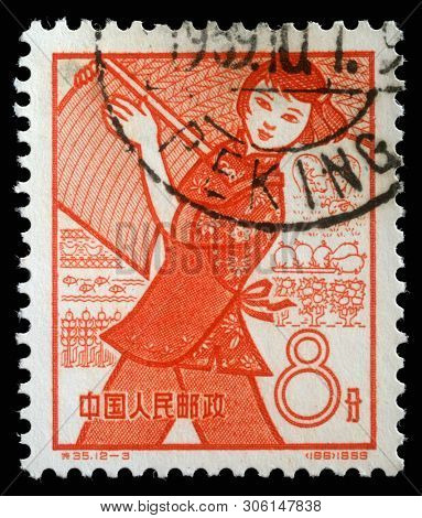 ZAGREB, CROATIA - SEPTEMBER 08, 2014: A stamp issued in the China shows Farming, the 1st Anniversary of People's Communes, circa 1959.