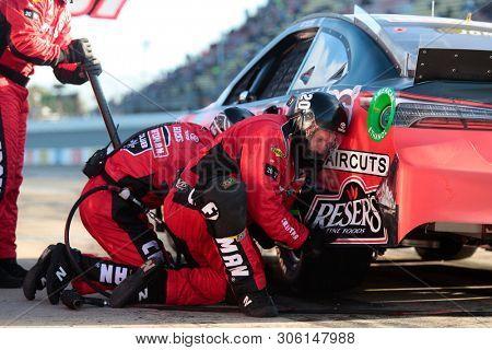 June 10, 2019 - Brooklyn, Michigan, USA: Erik Jones (20) makes a pit stop during the FireKeepers Casino 400 at Michigan International Speedway in Brooklyn, Michigan.