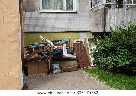 A Large Pile Of Rubbish Under The Windows Of A House For Any Purpose
