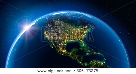 Planet Earth At Night With The Rising Sun With The Light Of Cities Illuminating A Detailed Exaggerat
