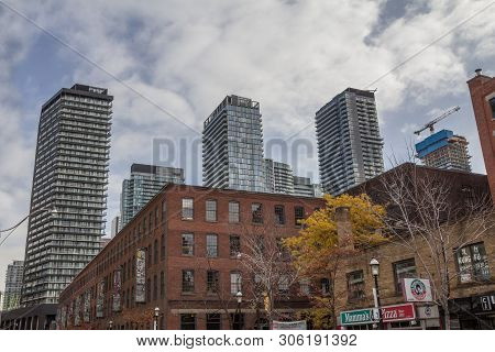Toronto, Canada - November 14, 2018: Old Individual Houses Surrounded By High Rise Condo Apartment B
