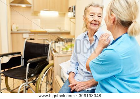 Social service consoles disabled senior woman in retirement home or nursing home