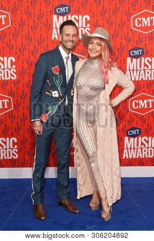 NASHVILLE - JUN 5: Meghan Linsey (R) and Tyler Cain attend the 2019 CMT Music Awards at Bridgestone Arena on June 5, 2019 in Nashville, Tennessee.
