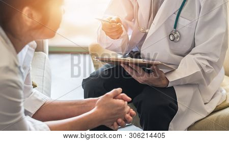 Woman Patient With Doctor Or Psychiatrist Consulting And Diagnostic Examining On Obstetric - Gynecol