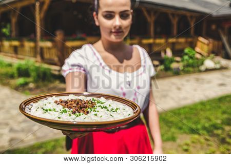Waitress With Slovak Potato Dumplings With Sheep Cheese Called Bryndzove Halusky - National Food Of