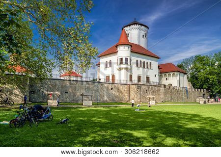 Zilina, Slovakia - May 25: People In Park In Front Of Budatin Castle On May 25, 2019 In Zilina
