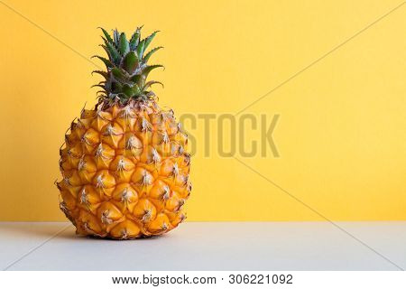 Ripe Pineapple Fruit On Yellow Gray Background. Copy Space.