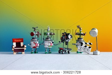 Cinema Television Team Robotic Director, Assistant With Clapperboard, Operator Cameraman Behind The