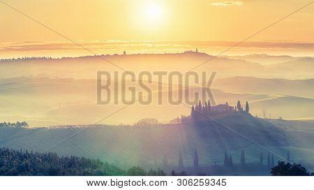 Beautiful foggy tuscany landscape at sunrise