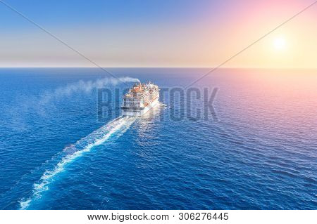 Cruise Ship Liner Goes Into Horizon The Blue Sea Leaving A Plume On The Surface Of The Water Seascap