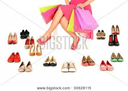 ein Bild von einer jungen Frau sitzend mit Einkaufstüten unter Schuhe over white background
