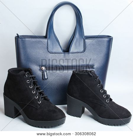 Black Suede Boots And Leather Fashion Bag On A White Background