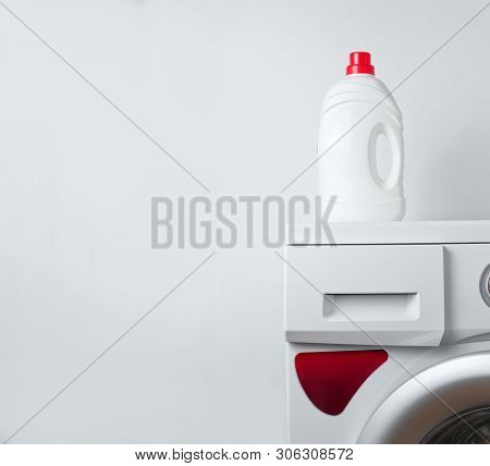 Bottle Of Washing Gel On A Washing Machine. White Background For Copy Space