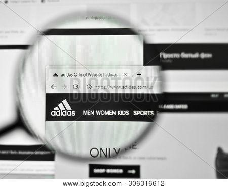 Ukraine, Odessa - April 25, 2019: Adidas Website Logo Through Magnifying Glass