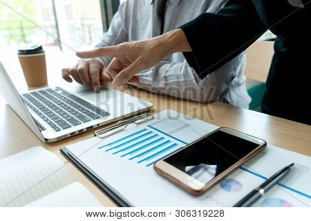 In office businessman in meeting analyses chart graphy marketing plan in business financial  audit project. Or Business adviser analyzing Budget, poster