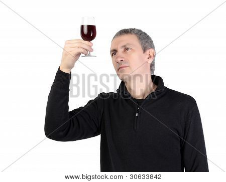 Man holding a glass of red port wine