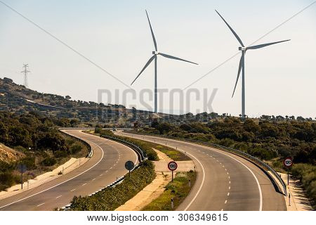Plasencia, Extremadura, Spain - March  13, 2019: A Pair Of Windmills In The Sierra Del Merengue Wind