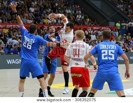 Kyiv, Ukraine - June 12, 2019: Ukraine (in Blue) And Denmark Handball Players Fight For A Ball Durin