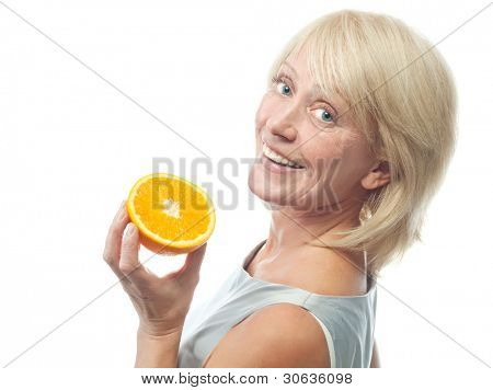 portrait of attractive  caucasian smiling mature woman blond isolated on white studio shot with orange