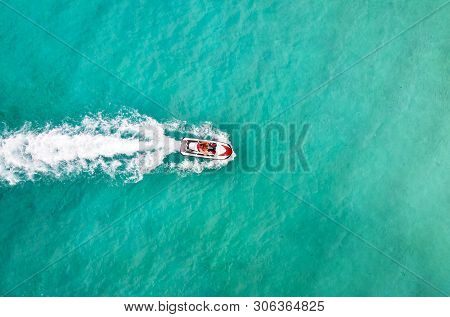 Beautiful Aerial View Jet Ski In Sea. Entertainment On Water Bikes In Sea Turquoise Water. Tourists
