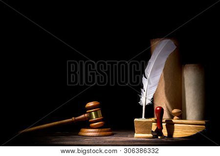 Wooden Judge Gavel Hammer, Old Inkstand With Feather Quill, Blotter, Seal Near Scrolls Against Black