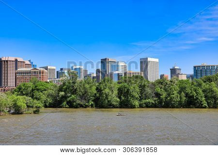 The Richmond, Virginia skyline as viewed from Floodwall park along the James River.  This is a popular travel destination.