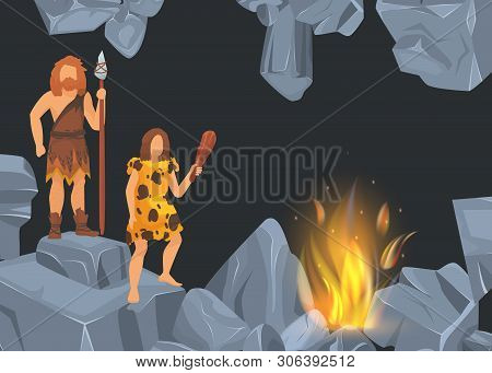 Caveman And Woman In Prehistoric Period In Rock Cave Before Fire Place. Banners With Black Backgroun