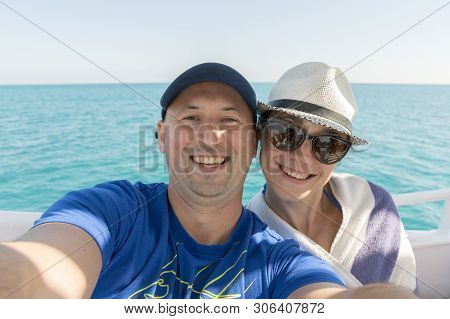 Happy Middle Aged Couple Taking Selfie On Yacht. Beautiful Happy Couple Taking Selfie On Yacht Deck