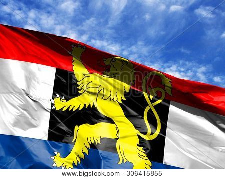 Waving Flag Of Benelux Close Up Against Blue Sky