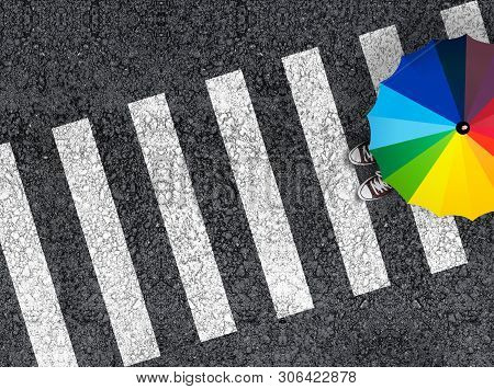 Pedestrian Crossing. Top View Of A Man With Colorful Rainbow Umbrella On A Pedestrian Crosswalk.