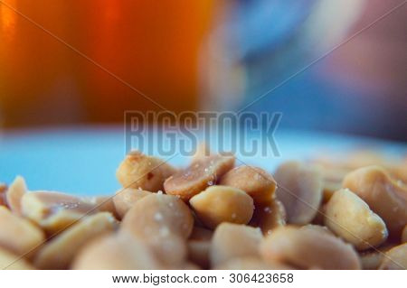 Nuts With Salt Close Up On A Blurred Beer Background