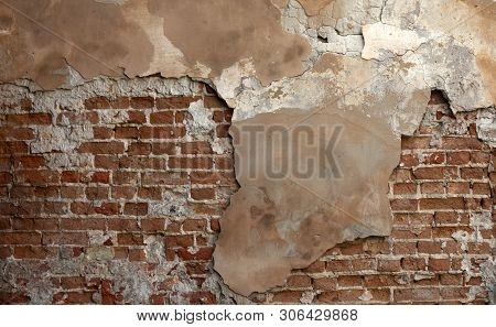 Empty Vintage Brick Wall Texture. Rough Wall Surface. Grungy Brickwall. Abstract Pattern. Copy Space