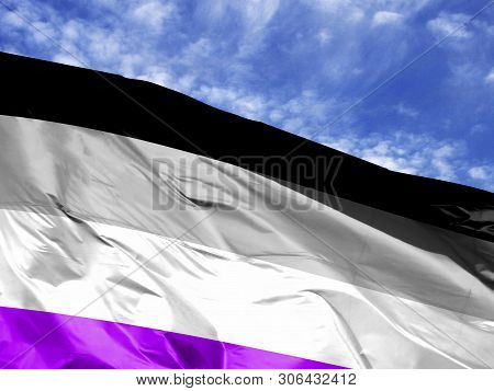 Waving Flag Of Asexual Close Up Against Blue Sky
