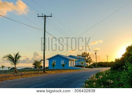 Little Cayman, Cayman Islands, Nov 2018, Blue House Between The Caribbean Sea And Guy Banks Rd At Su