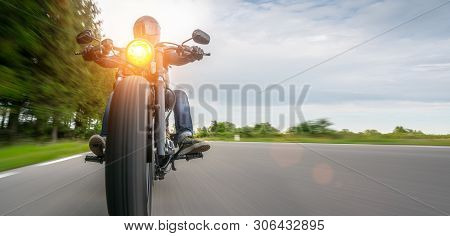 Motorbike On The Road Driving Fast. Having Fun On The Empty Highway On A Motorcycle  Journey. Copysp