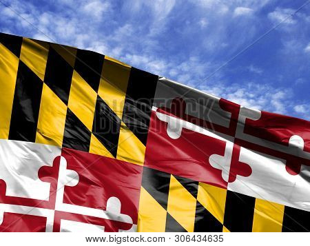 Waving Flag State Of Maryland Close Up Against Blue Sky