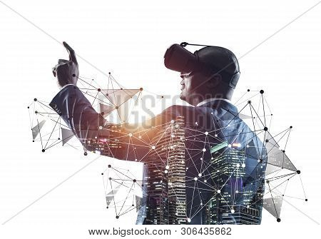 African Businessman Wearing Vr Headset Working With Virtual System. New Reality Modeling And Design.