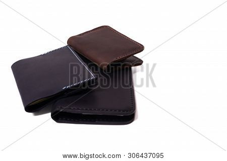 Handmade Leather Brown Cardholder, Blue Passport Cover And Black Purse Isolated On White Background