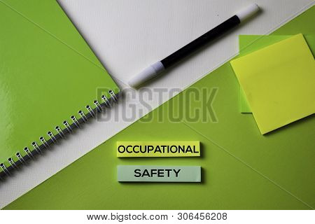 Occupational Safety Text On Top View Office Desk Table Of Business Workplace And Business Objects.