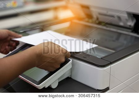 Men Press The Button Of The Copier. Man Copying Paper From Photocopier. Men Use Printing Machines. T